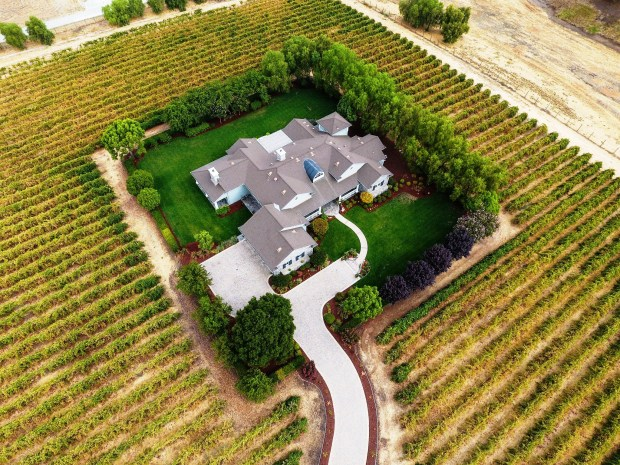You can live among the grapevines at this 5,000-square-foot estate in San Martin, which features four bedrooms, three full bathrooms and two half bathrooms,