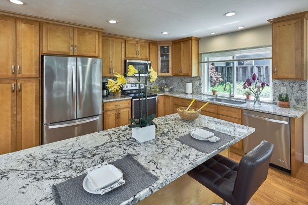 The kitchen sparkles with new cabinets, granite counters and new stainless steel appliances.