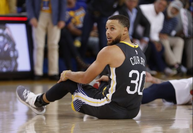 Golden State Warriors' Stephen Curry (30) sits on the court after missing a 3-point basket against the New Orleans Pelicans in the second quarter of Game 2 of the NBA Western Conference semifinals at Oracle Arena in Oakland, Calif., on Tuesday, May 1, 2018. (Nhat V. Meyer/Bay Area News Group)