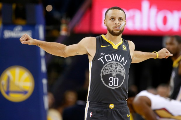 Golden State Warriors' Stephen Curry (30) stretches in the in the first quarter of Game 2 of the NBA Western Conference semifinals against the New Orleans Pelicans at Oracle Arena in Oakland, Calif., on Tuesday, May 1, 2018. (Nhat V. Meyer/Bay Area News Group)