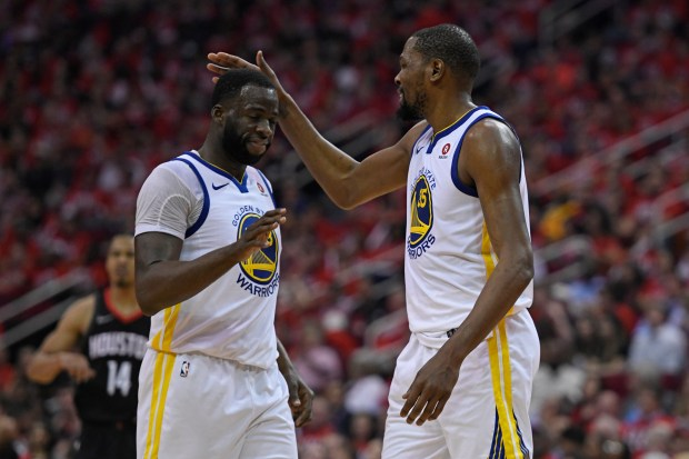 Golden State Warriors' Kevin Durant (35) congratulates teammate Golden State Warriors' Draymond Green (23) after a basket during the third quarter of Game 1 of the NBA Western Conference finals at Toyota Center in Houston, Texas, on Monday, May 14, 2018. The Golden State Warriors defeated the Houston Rockets 119-106. (Jose Carlos Fajardo/Bay Area News Group)