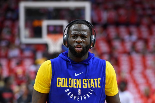 Golden State Warriors' Draymond Green (23) warms up before the start of Game 1 of the NBA Western Conference finals at Toyota Center in Houston, Texas, on Monday, May 14, 2018. (Jose Carlos Fajardo/Bay Area News Group)
