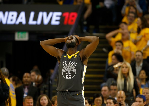 Golden State Warriors' Draymond Green (23) reacts to an offensive foul called against him during their game against the Houston Rockets in the third quarter of Game 4 of the NBA Western Conference finals at Oracle Arena in Oakland, Calif., on Tuesday, May 22, 2018. (Nhat V. Meyer/Bay Area News Group)