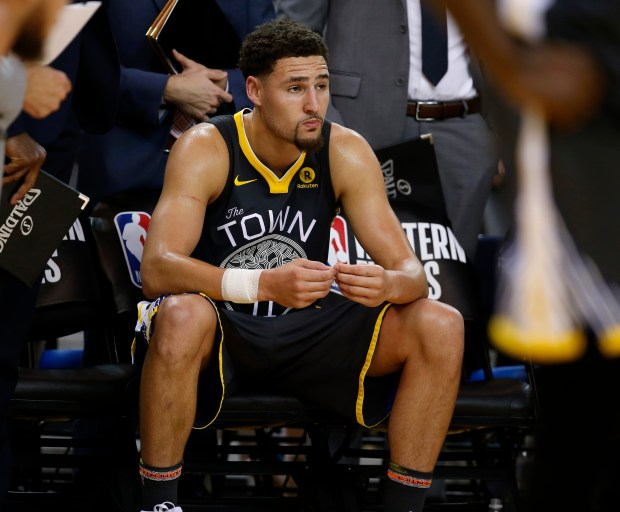 Golden State Warriors' Klay Thompson (11) sits on the bench during the final seconds of their 95-92 loss to the Houston Rockets in the fourth quarter of Game 4 of the NBA Western Conference finals at Oracle Arena in Oakland, Calif., on Tuesday, May 22, 2018. (Nhat V. Meyer/Bay Area News Group)