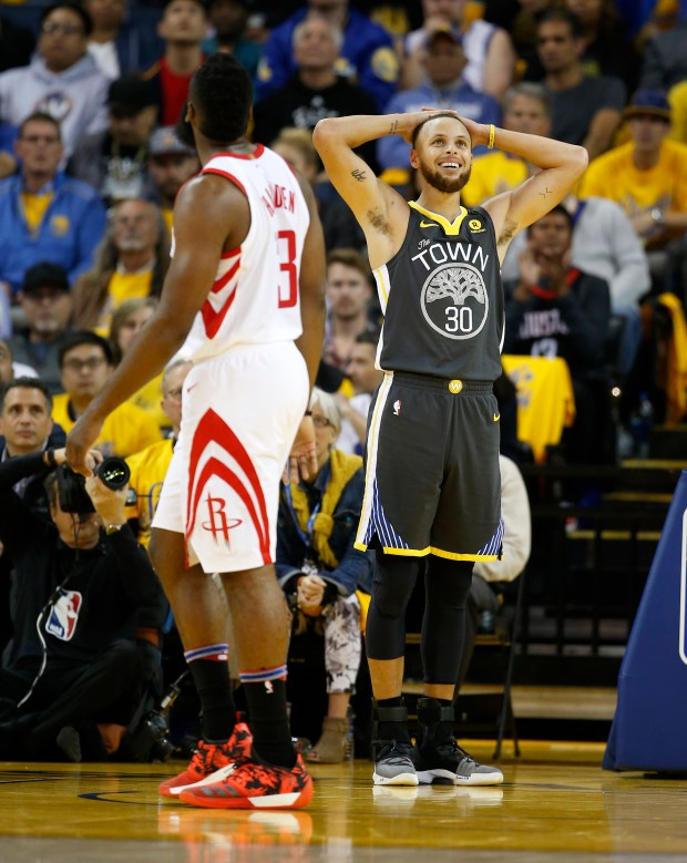 Golden State Warriors' Stephen Curry (30) reacts to a foul against him during their game against the Houston Rockets in the second quarter of Game 4 of the NBA Western Conference finals at Oracle Arena in Oakland, Calif., on Tuesday, May 22, 2018. (Nhat V. Meyer/Bay Area News Group)