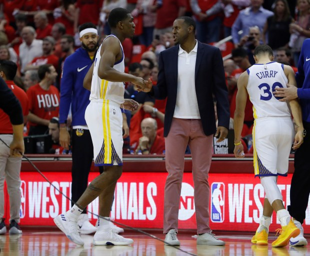 Golden State Warriors' Andre Iguodala (9) talks to Golden State Warriors' Kevon Looney (5) before their game against the Houston Rockets for Game 5 of the NBA Western Conference finals at the Toyota Center in Houston, Texas., on Thursday, May 24, 2018. (Nhat V. Meyer/Bay Area News Group)