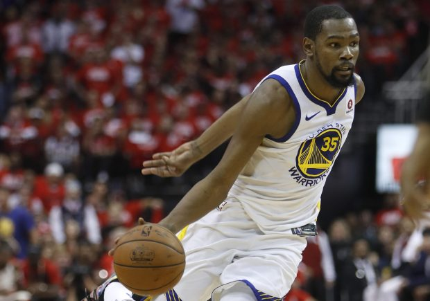 Golden State Warriors' Kevin Durant (35) dribbles against the Houston Rockets in the second quarter of Game 5 of the NBA Western Conference finals at the Toyota Center in Houston, Texas., on Thursday, May 24, 2018. (Nhat V. Meyer/Bay Area News Group)