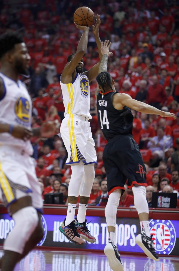 Golden State Warriors' Kevin Durant (35) takes a shot against Houston Rockets' Gerald Green (14) in the first quarter of Game 7 of the NBA Western Conference finals at the Toyota Center in Houston, Texas, on Monday, May 28, 2018. (Nhat V. Meyer/Bay Area News Group)