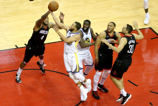Golden State Warriors' Stephen Curry (30) drives to the basket against Houston Rockets' PJ Tucker (4) during the third quarter in Game 7 of the NBA Western Conference finals at Toyota Center in Houston, Texas, on Monday, May 28, 2018. (Anda Chu/Bay Area News Group)