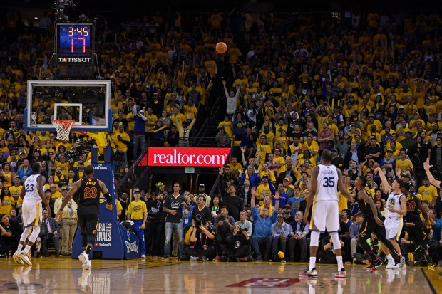 Golden State Warriors' Klay Thompson (11) watches the flight of his 3-point basket as he scores against the Cleveland Cavaliers in overtime of Game 1 of the NBA Finals at Oracle Arena in Oakland, Calif., on Thursday, May 31, 2018. Golden State Warriors defeated the Cleveland Cavaliers 124-114 in overtime. (Jose Carlos Fajardo/Bay Area News Group)