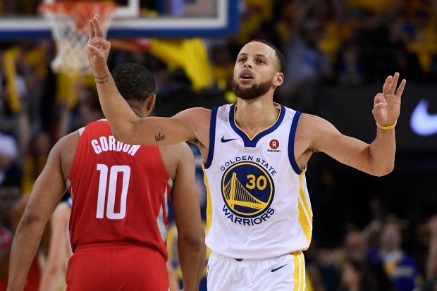 Golden State Warriors' Stephen Curry (30) gestures after teammate Klay Thompson (11) makes a 3-point basket against the Houston Rockets during the fourth quarter of Game 6 of the NBA Western Conference finals at Oracle Arena in Oakland, Calif., on Saturday, May 26, 2018. The Golden State Warriors defeated the Houston Rockets 115-86. (Jose Carlos Fajardo/Bay Area News Group)