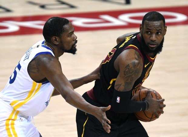 Golden State Warriors' Kevin Durant (35) guards Cleveland Cavaliers' LeBron James (23) in the first period of Game 1 of the NBA Finals at Oracle Arena in Oakland, Calif., on Thursday, May 31, 2018. (Doug Duran/Bay Area News Group)
