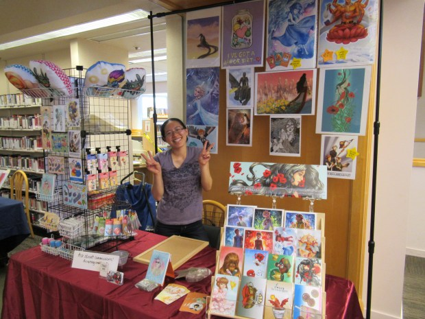 Amanda Lee, an artist, is shown at her booth inside the Menlo Park Library during the 2017 Comic Con. She will be back again for this year's event, which takes place Saturday, May 19. (Menlo Park Library)
