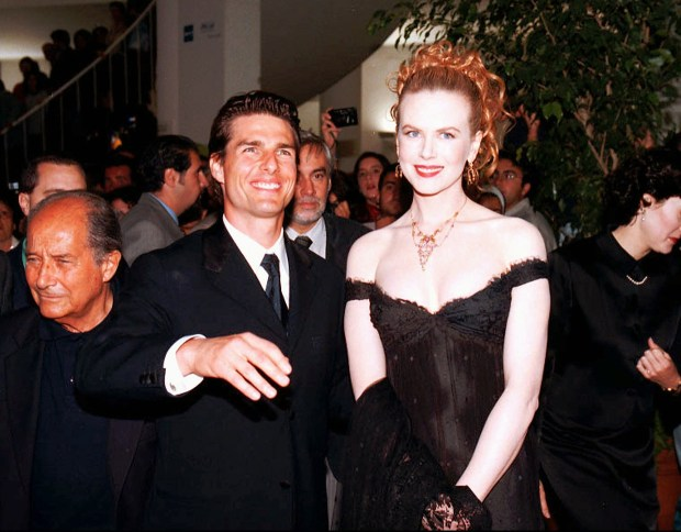 "Tom Cruise and Nicole Kidman arrive for the opening gala of Jane Campion's movie ""The Portrait of a Lady"", in which Kidman plays the leading role, at the Venice film festival Friday night, September 6 1996. At left, Gillo Pontecorvo, the Italian director of the film festival. The ""Golden Lions"", the main prizes to movies in competition at the festival, will be awarded in Venice Saturday night. (AP Photo)"