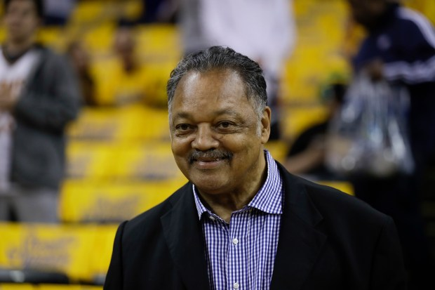 Jesse Jackson watches as players warm up before Game 1 of basketball's NBA Finals between the Golden State Warriors and the Cleveland Cavaliers in Oakland, Calif., Thursday, May 31, 2018. (AP Photo/Marcio Jose Sanchez)