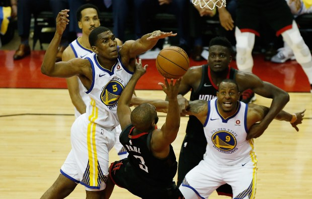 Chris Paul #3 of the Houston Rockets goes up against Kevon Looney #5 of the Golden State Warriors in the second half of Game Two of the Western Conference Finals of the 2018 NBA Playoffs at Toyota Center on May 16, 2018 in Houston, Texas. (Photo by Tim Warner/Getty Images)