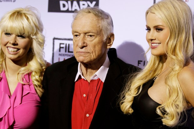 """Hugh Hefner, center, Shera Bechard, right, and Anna Sophia Berglund arrives at the premiere of """"The Rum Diary"""" in Los Angeles, Thursday, Oct. 13, 2011. """"The Rum Diary"""" opens in theaters Oct. 28, 2011. (AP Photo/Matt Sayles)"""