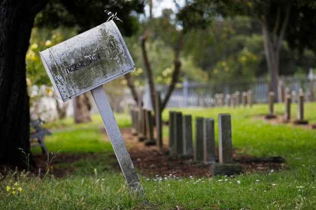 A weathered mailbox with information about the Mare Island Naval Cemetery in Vallejo, Calif., tilts on Friday, May 25, 2018. The Mare Island Naval Cemetery is the first Naval cemetery in the Pacific founded in 1858 and the final resting place for over 800 veterans, including three Congressional Medal of Honor recipients and Anna Key Turner, the daughter of Francis Scott Key. (Laura A. Oda/Bay Area News Group)