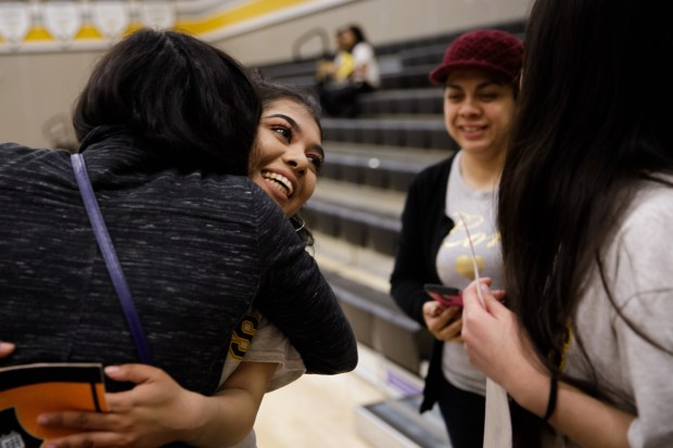 Graduating senior Daisy Rodriguez, 18, of San Jose gets a hug during a school event, where college-bound seniors announced their university or college choice in front of their family members and fellow students, on May 18, 2018, at Cristo Rey San Jose Jesuit High School. Rodriguez will attend Princeton University in New Jersey in the fall. (Dai Sugano/Bay Area News Group)