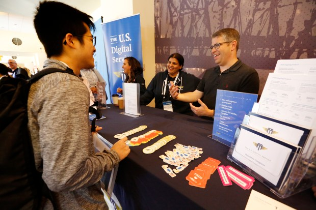 Matt Cutts, U.S. Digital Service acting administrator, right, and Seems Daryanani, senior technical recruiter/ diversity and inclusion, talk with Edmund Loo from San Mateo, left, at the Code For America Summit at the Oakland Marriott Convention Center in Oakland, Calif., on Thursday, May 31, 2018. Cutts is in Silicon Valley/Bay Area to recruit tech workers to come work with him in Washington, D.C. (Laura A. Oda/Bay Area News Group)