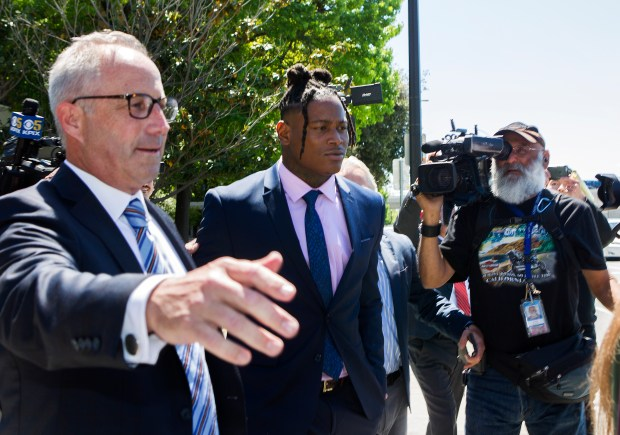 San Francisco 49ers linebacker Reuben Foster, center, is led to his car by his attorney Joshua Bentley, left, after leaving the Santa Clara Hall of Justice after his preliminary hearing on his domestic-violence case in San Jose, California, on Thursday, May 17, 2018. (LiPo Ching/Bay Area News Group)
