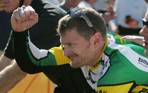 Floyd Landis of Phonak pumps his fist as he heads to the podium with a first place winning time of 35:58.91 during the Amgen Tour of California bicycle race in San Jose, California on Wednesday, February 22, 2006. Wednesday's race (stage 3) was a 17-mile time trail in San Jose, California. (Jim Gensheimer/Mercury News)
