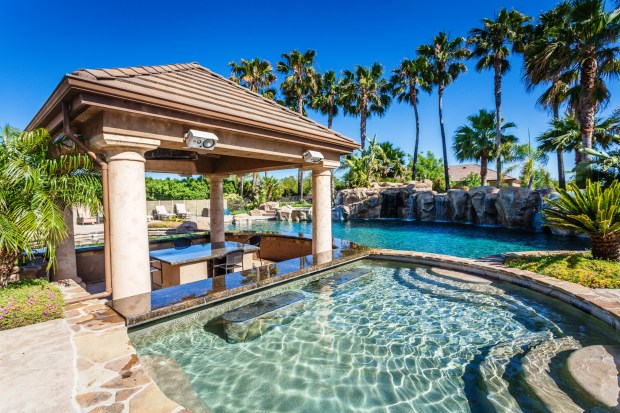 The property's pool with swim-up bar makes you feel like you're at a resort.
