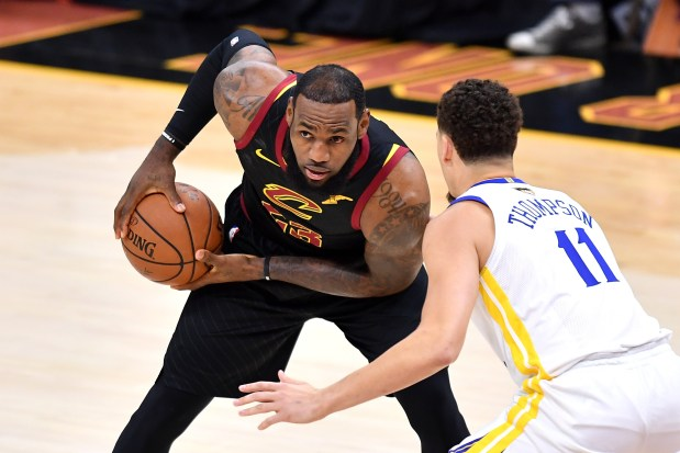 LeBron James #23 of the Cleveland Cavaliers is defended by Klay Thompson #11 of the Golden State Warriors in the first quarter during Game Three of the 2018 NBA Finals at Quicken Loans Arena on June 6, 2018 in Cleveland, Ohio. (Photo by Jamie Sabau/Getty Images)