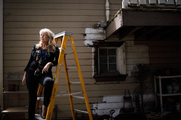 "Julia Hutton's former business partner, Karen Smith of San Jose, poses for a photograph on May 30, 2018, in front of her ""carriage house"" where she found, in December, the original VHS cassette tapes featuring oral histories of former 49ers talking in 1990 for a production meant as a fundraiser for the ALS Association. The project was relaunched after Dwight Clark announced in March 2017 that he has ALS. (Dai Sugano/Bay Area News Group)"