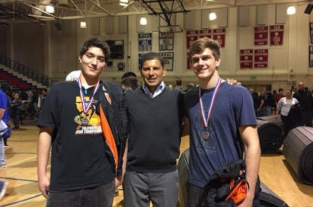 Ricardo Garcia, who has coached the Los Gatos High wrestling team the pastthree seasons, is flanked by two of his wrestlers -- Michael Wiley, left, and Matthew McLean -- after the CCS championships in 2017.