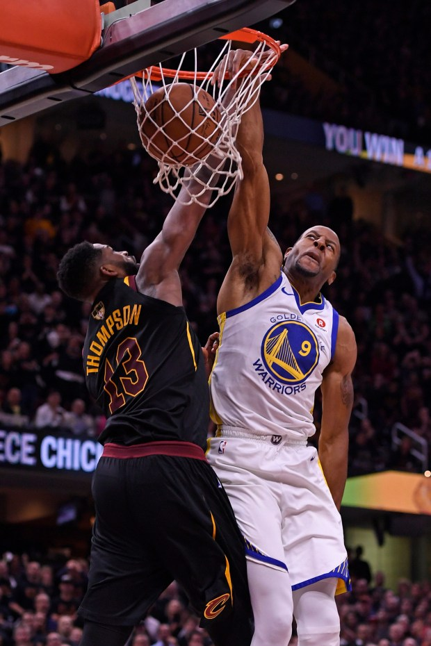 Golden State Warriors' Andre Iguodala (9) dunks over Cleveland Cavaliers' Tristan Thompson (13) during the fourth quarter of Game 3 of the NBA Finals at Quicken Loans Arena in Cleveland, Ohio, on Wednesday, June 6, 2018. The Golden State Warriors defeated the Cleveland Cavaliers110-102. (Jose Carlos Fajardo/Bay Area News Group)