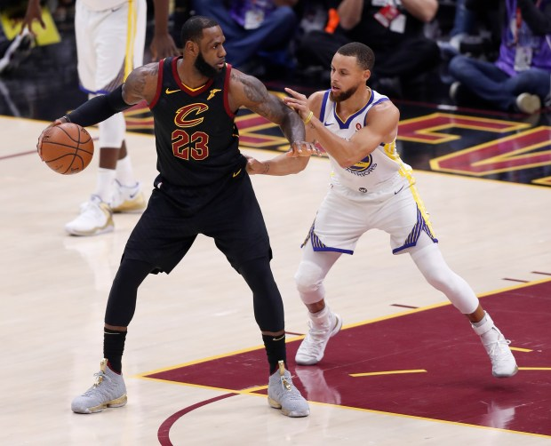 Golden State Warriors' Stephen Curry (30) defends against Cleveland Cavaliers' LeBron James (23) in the first quarter of Game 3 of the NBA Finals at Quicken Loans Arena in Cleveland, Ohio, on Wednesday, June 6, 2018. (Nhat V. Meyer/Bay Area News Group)