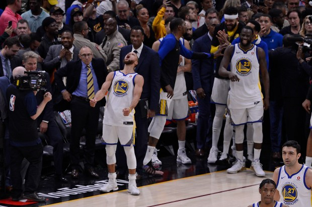 Golden State Warriors' Stephen Curry (30) celebrates after defeating the Cleveland Cavaliers in Game 4 of the NBA Finals at Quicken Loans Arena in Cleveland, Ohio, on Friday, June 8, 2018. The Golden State Warriors defeated the Cleveland Cavaliers 108-85. (Jose Carlos Fajardo/Bay Area News Group)