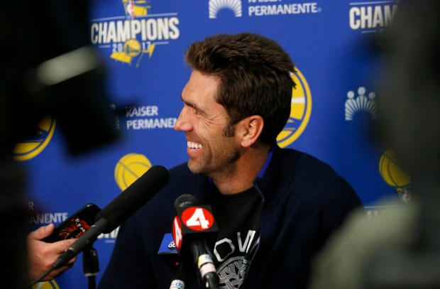 Golden State Warriors general manager Bob Myers is framed between TV cameras as he speaks to the media at the Rakuten Performance Center in downtown Oakland, Calif., on Monday, June 11, 2018. The Warriors NBA championship parade begins Tuesday at 11:00 a.m. in downtown Oakland. (Jane Tyska/Bay Area News Group)
