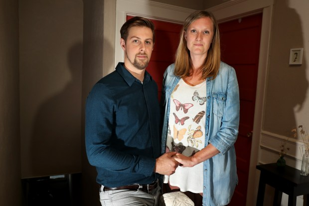 Lucas S. and his wife Amanda M. are photographed in their home in Oakland, Calif., on Thursday, June 14, 2018. The couple are suing a San Francisco fertility clinic after a tank containing Amanda's eggs became too hot and damaged her eggs along with eggs belonging to other women. Amanda decided to use the fertility clinic because she was fighting cancer. (Ray Chavez/Bay Area News Group)