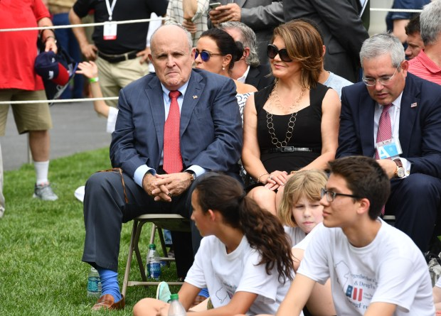 President Donald Trump's lawyer, Rudy Giuliani(L) sits outside on the South Lawn at the White House before US President Donald Trump delivers remarks and participates in the White House Sports and Fitness Day on May 30, 2018 in Washington,DC. (Photo by Nicholas Kamm / AFP) (Photo credit should read NICHOLAS KAMM/AFP/Getty Images)