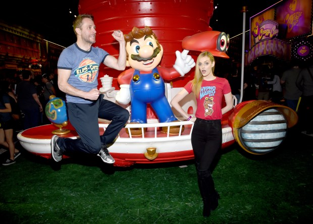 LOS ANGELES, CA - JUNE 13: Comedian Chris Hardwick and model Lydia Hearst visit the Nintendo booth at the 2017 E3 Gaming Convention at Los Angeles Convention Center on June 13, 2017 in Los Angeles, California. (Photo by Michael Kovac/Getty Images for Nintendo)