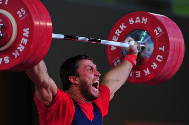 Dmitriy Klokov of Russia competes in the men's 105 kg weightlifting competition at the World Weightlifting Championships in Antalya on September 26, 2010. AFP PHOTO / MUSTAFA OZER (Photo credit should read MUSTAFA OZER/AFP/Getty Images)