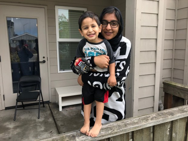Sadia Kahn with her son Hashim outside their new apartment in University Village. Photo Credit: Vanessa Rancaño/KQED.