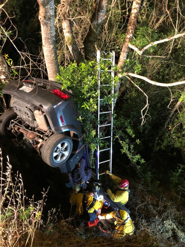 Santa Clara County firefighters rescued a man Wednesday night after his car crashed about 50 feet down an embankment in the Santa Cruz Mountains. It took the 'jaws of life' and more than two hours to extricate the man from his vehicle. (Photograph courtesy of Luisa Rapport)