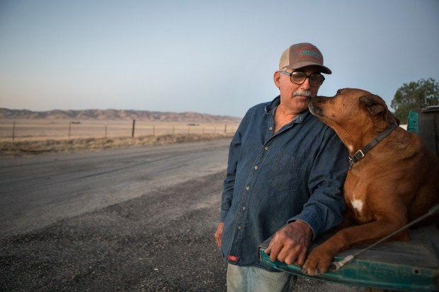 Mark Cirelli, 56, of Hollister, poses for a portrait with his dog, Nitro, in front of the Panoche Inn, in Panoche (San Benito County), California on Wednesday, June 13, 2018. The Inn lies near the border of the proposed three Californias: Northern California (Merced County), California (San Benito County), and Southern California (Fresno County) (LiPo Ching/Bay Area News Group)