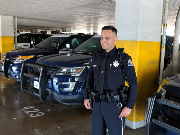 San Jose police Officer Jesse Villaescusa stands at SJPD headquarters on June 8, 2018. He is donating bone marrow this month to help a sick child out of state. (Robert Salonga/Bay Area News Group)