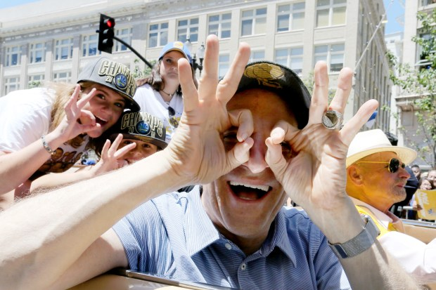 Golden State Warriors co-owner Peter Guber makes the signal of three championships during the Warriors championship parade in downtown Oakland, Calif., on Tuesday, June 12, 2018. (Ray Chavez/Bay Area News Group)