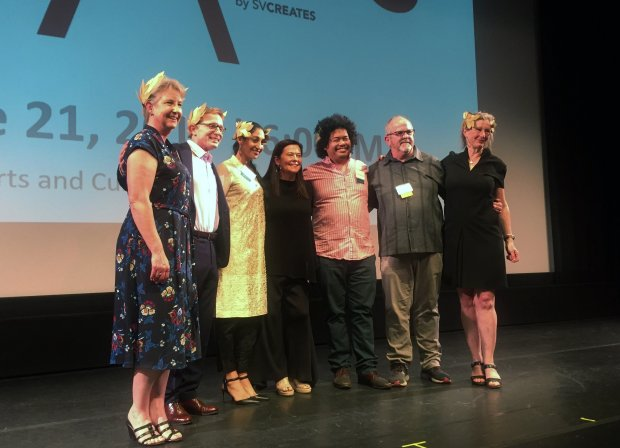 SVCreates CEO Connie Martinez, center, poses on June 21, 2018, at theMexican Heritage Plaza theater with the organization's 2018 Arts Laureates, from left: Kimberley Mohne Hill, Pancho Jimenez, Farah Yasmeen Shaikh, Tasi Alabastro, Joel Slayton and Gail Wight. (Sal Pizarro/Bay Area News Group)