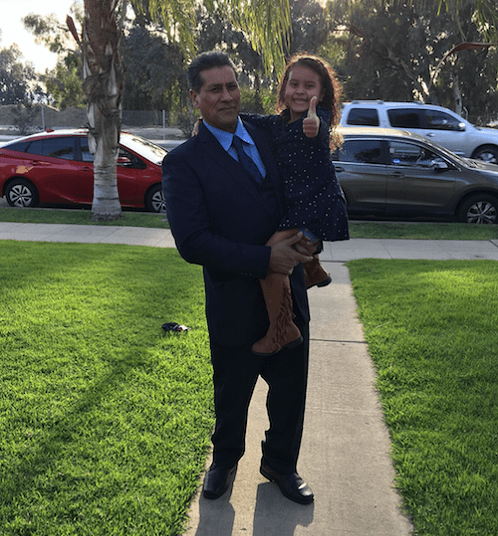 Arleta resident Jose Luis Garcia, pictured holding his six-year-old granddaughter Marley, was detained by ICE agents on Sunday. Garcia has permanent resident status in the United States. (Courtesy)