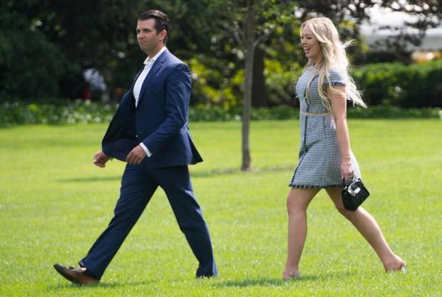 Donald Trump, Jr., and Tiffany Trump, children of US President Donald Trump, walk to Marine One prior to departing from the South Lawn of the White House on June 1, 2018 in Washington, DC, as he travels to Camp David for the weekend. (Photo by SAUL LOEB / AFP) (Photo credit should read SAUL LOEB/AFP/Getty Images)