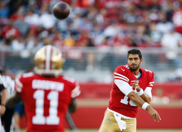 afe119196 San Francisco 49ers quarterback Jimmy Garoppolo throws to Marquise Goodwin  before their preseason NFL game against the Dallas Cowboys at Levi s  Stadium.
