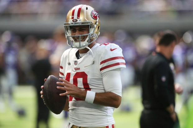 San Francisco 49ers quarterback Jimmy Garoppolo warms up before an NFL  football game against the Minnesota Vikings 7d40b04d6