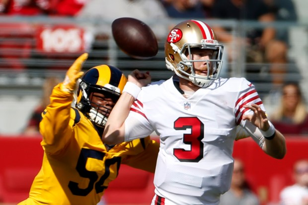 46d15826 C.J. Beathard of the San Francisco 49ers is sacked by Samson Ebukam of the  Los Angeles Rams forcing a 1st quarter turnover at Levi's Stadium in Santa  Clara, ...