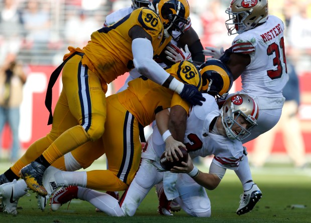 17583cbd000 San Francisco 49ers starting quarterback C.J. Beathard (3) is sacked by Los  Angeles Rams  Michael Brockers (90) and Los Angeles Rams  Aaron Donald (99)  in ...